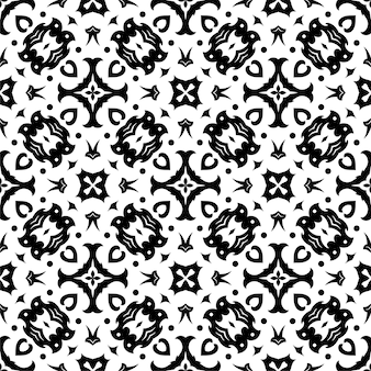 黒と白のシームレスな飾りの形。シンプルなパターンの抽象的な背景