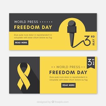 世界のプレスの自由の日のための黒と黄色のバナー