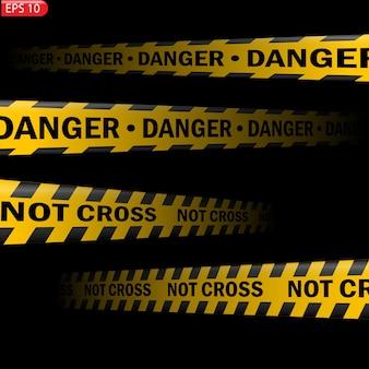 黒と黄色の注意線が分離されています。リアルな警告テープ。危険の兆候。