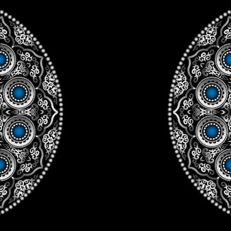 Black background with silver round ornament pattern with blue gemstones