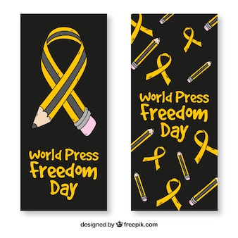 Black banners with pencils and ribbons for world press freedom day