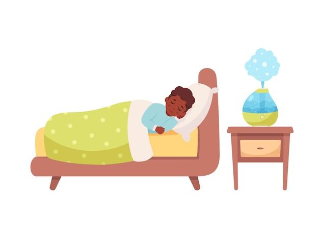 部屋の健康的な睡眠で空気加湿器で眠っている黒人の少年