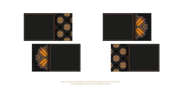 Черный дизайн визитной карточки с оранжевым славянским орнаментом. стильные визитки с пространством для текста и роскошными узорами.