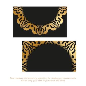 金色の曼荼羅パターンと黒の名刺テンプレート