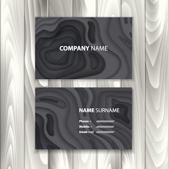 深い黒の色の紙のカット形状3d抽象的な紙アートと背景を持つ黒の名刺