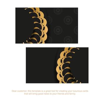 金色のインドの装飾が施された黒い名刺