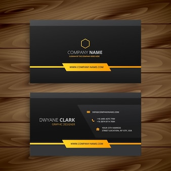 Black business card with orange decoration