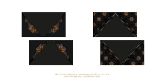 Черная визитная карточка с оранжевым славянским орнаментом. готовый к печати дизайн визитки с пространством для текста и роскошными узорами.