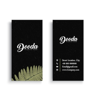 Black business card with palm tree leaf