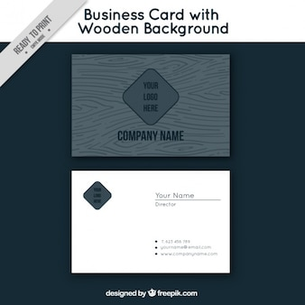 Black business card with a wooden background