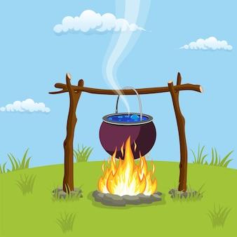 모닥불 위에 검은 캠핑 냄비