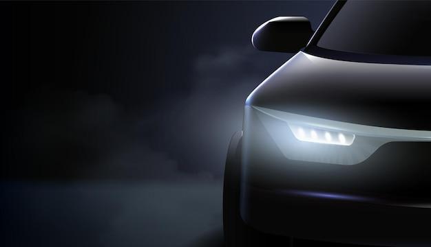 검은 색 자동차 헤드 라이트 광고 구성과 비싼 자동차의 오른쪽 헤드 라이트가 어둠 속에서 차가운 조명으로 빛납니다