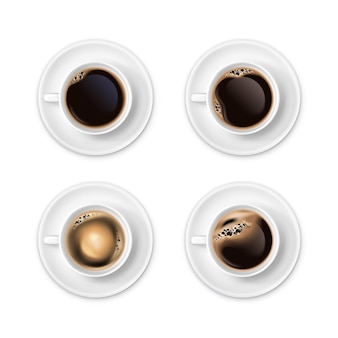 Black coffee with foam in white cups top view realistic set isolated