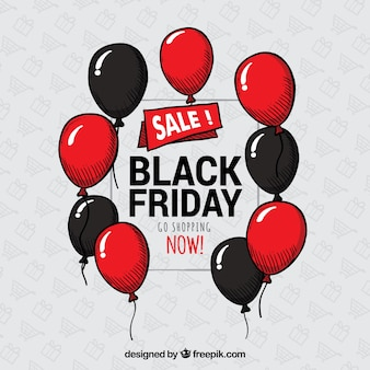 Sfondo nero di venerdì con palloncini rossi e neri
