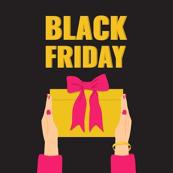 Black friday banner. woman's hands holding a yellow gift with pink bow.