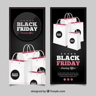 Striscioni black friday con borse della spesa Vettore gratuito