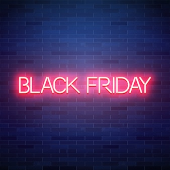Black friday neon text on brick background