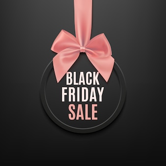 Black friday round banner with pink ribbon and bow, on black background. brochure or banner template.
