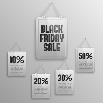 Tavole pubblicitarie di vendita del black friday con iscrizioni e diverse percentuali di sconto.
