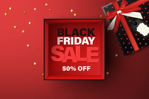Black friday sale background, top view of empty open gift box on red background.