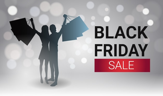 Black friday sale banner design with silhouette couple holding shopping bags over white lights bokeh