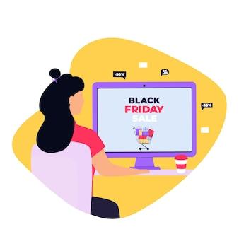 검은 금요일 판매 배너입니다. 소녀는 컴퓨터에서 온라인으로 구매합니다.