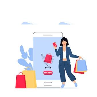 ブラックフライデーセールのバナー。女の子はスマートフォンからオンラインで購入します。女性はクレジットカードと買い物袋を持っています