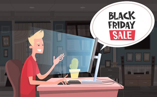 Black friday sale chat bubble over man sitting at computer desktop