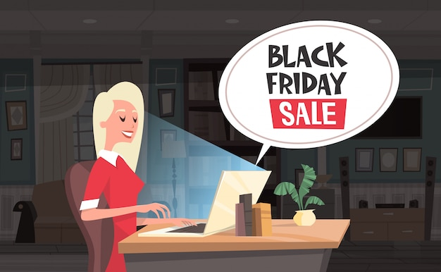 Black friday sale chat bubble over woman using laptop computer