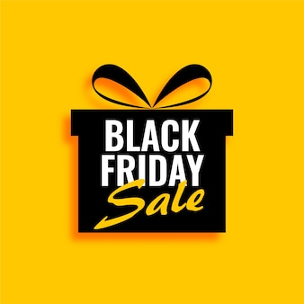 Black friday sale gift on yellow background