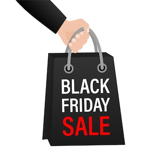 Black friday sale package with hand on white