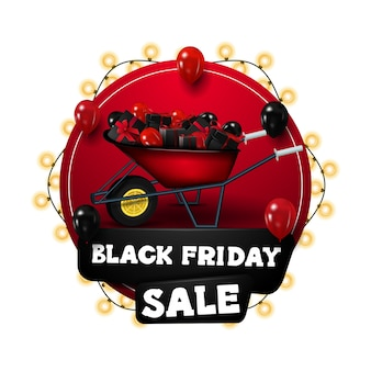 Black friday sale, red circle discount banners wrapped with garlands, decorated with wheelbarrow with presents and balloons. discount banner isolated