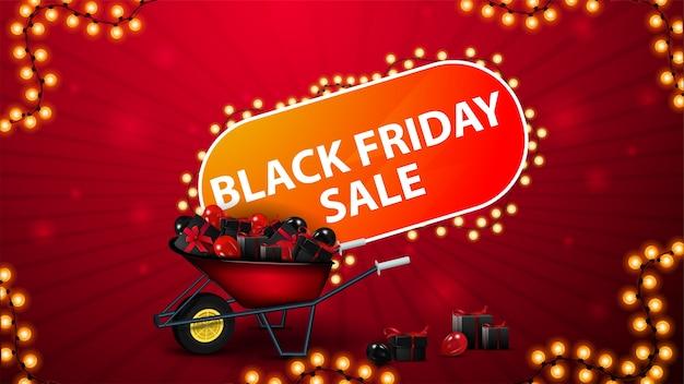 Распродажа в черную пятницу, красный горизонтальный баннер со скидкой с тачкой, полной подарков, большим заголовком и рамкой с гирляндой. красный купон на скидку для сайта