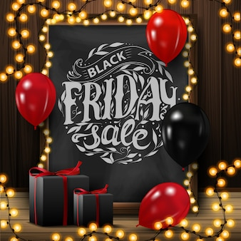 Black friday sale, square banner with chalkboard with beautiful lettering, garland, balloons and gifts.