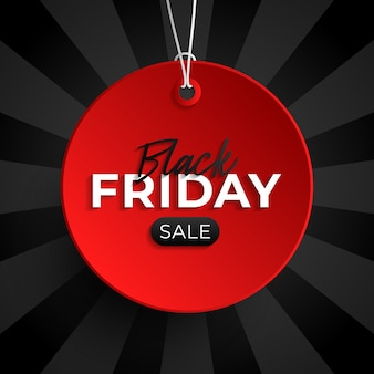 Black friday sale tag red circle banner and the rope hanging on black background.