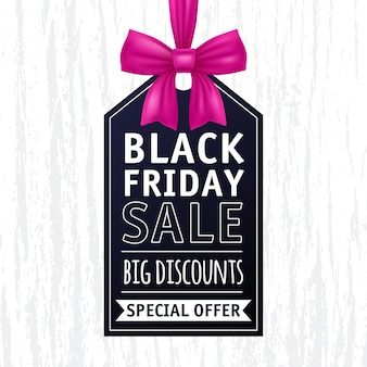 Black friday sale tag with pink bow illustration.