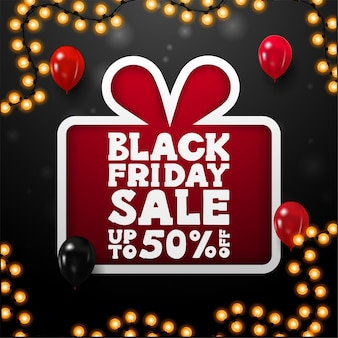 Black friday sale, up to 50% off, black square discount banner with large red present in paper cut style with offer, red and black balloons and garland frame