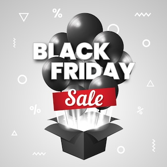 Black friday sale with black balloons out of cardboard box