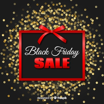 Black friday sales background with glitter and ribbon