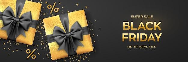 ブラックフライデースーパーセール。黒のリボンが付いたリアルなゴールドのギフトボックス。現在のボックスと金色のパーセント記号が付いた暗い背景。横長のバナー、ポスター、ヘッダーのウェブサイト。ベクトルイラスト。