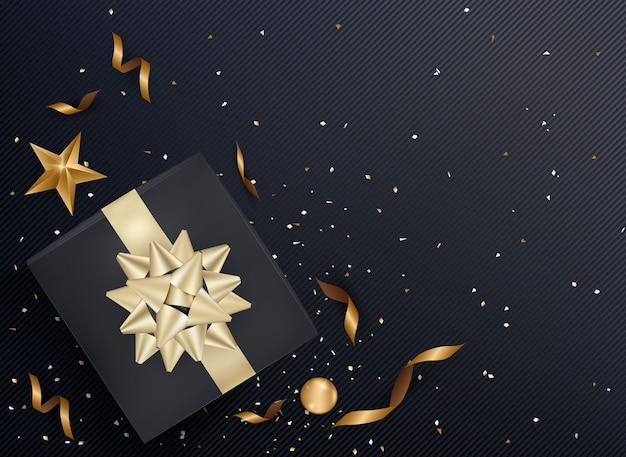 Black gift box and gold bow ribbons with confetti  dark texture