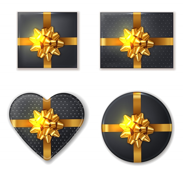 Black gift box and golden bow