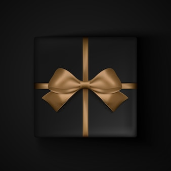Black gift box with gold ribbon bow for black friday sale