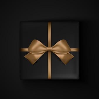 ブラックフライデーセールのゴールドリボンリボン付きブラックギフトボックス