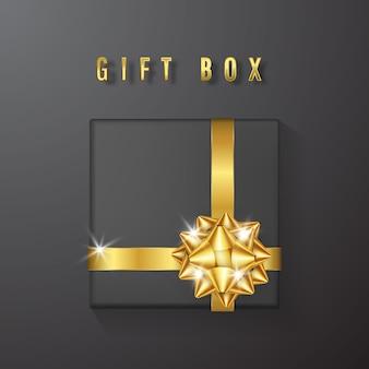 Черная подарочная коробка с золотым бантом и лентой сверху