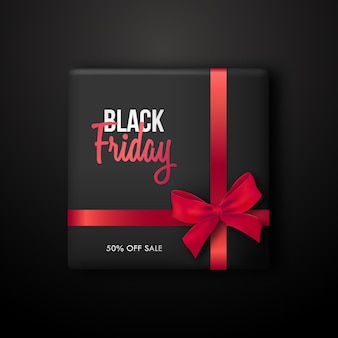 Black gift box with red ribbon for black friday sale.