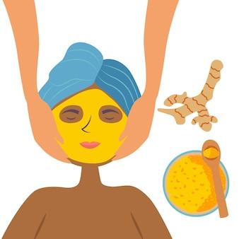 Черная девушка в спа-салоне получает массаж лица с куркумой, маску для лица косметическое очищение и увлажнение