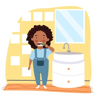 A black girl with dreadlocks in pajamas is brushing her teeth in the bathroom.