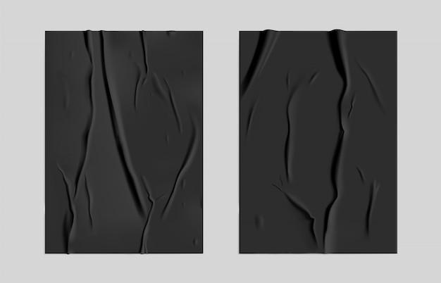 Black glued paper set with wet wrinkled effect on gray background. black wet paper poster template set with crumpled texture. realistic posters