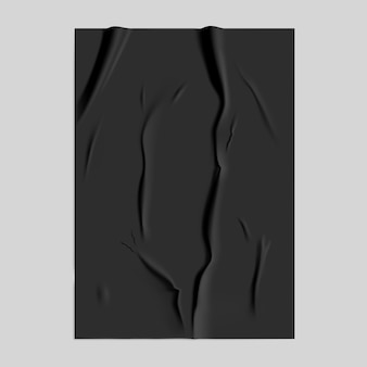 Black glued paper with wet wrinkled effect on gray background. black wet paper poster template with crumpled texture.